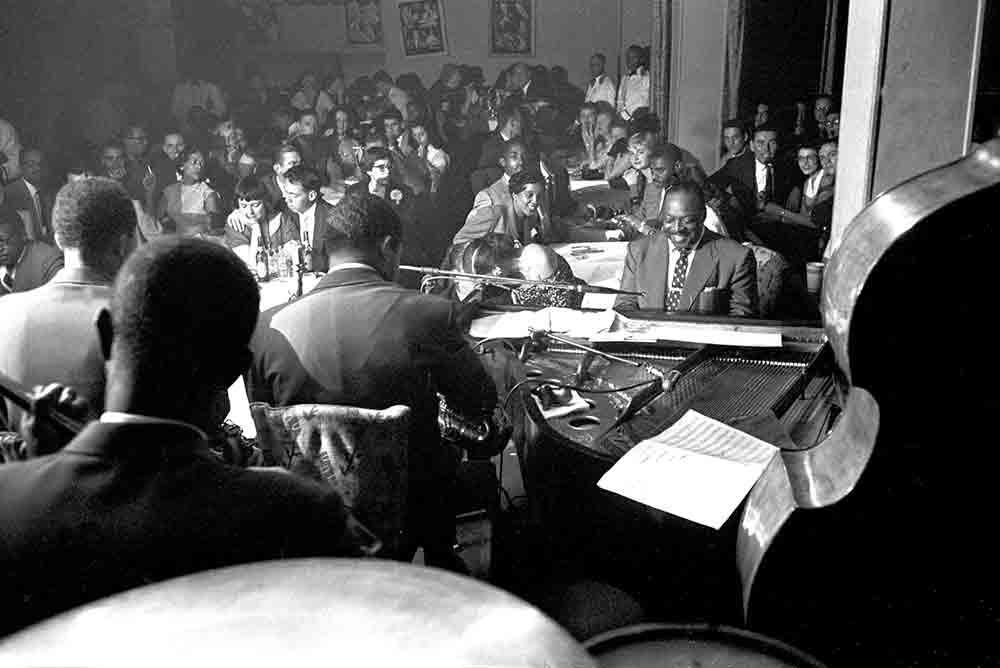 Count Basie Band performs in a nightclub, 1954.