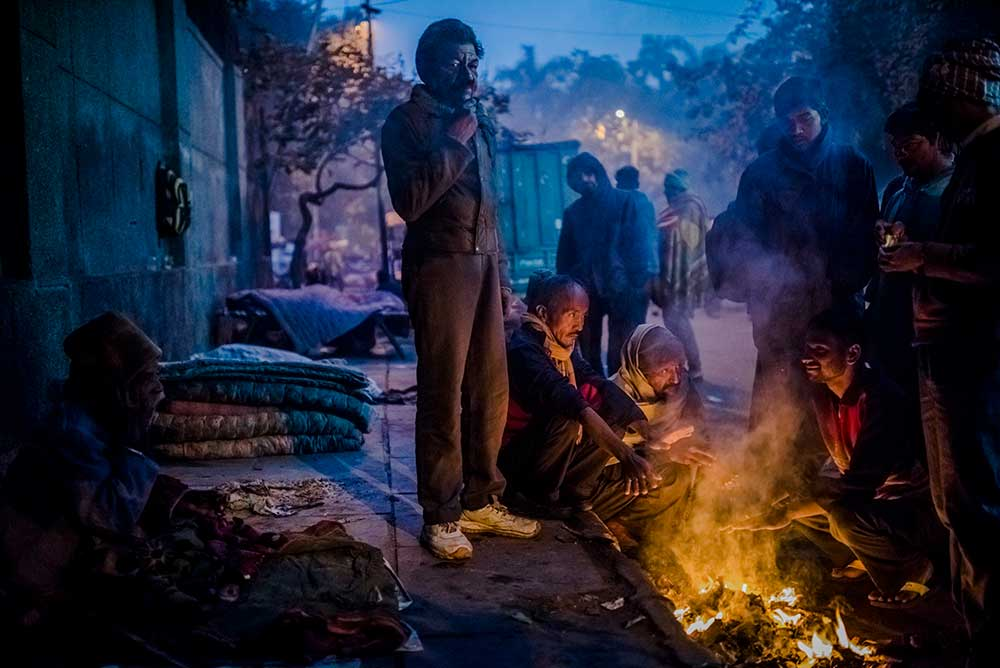 Homeless men in Old Delhi, India, 2016.