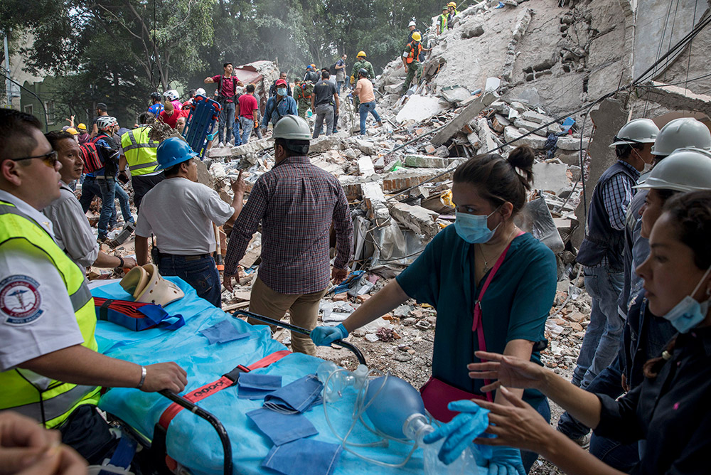 Rescuers and volunteers working on a collapsed building in the Condesa neighborhood in Mexico City, 2017.